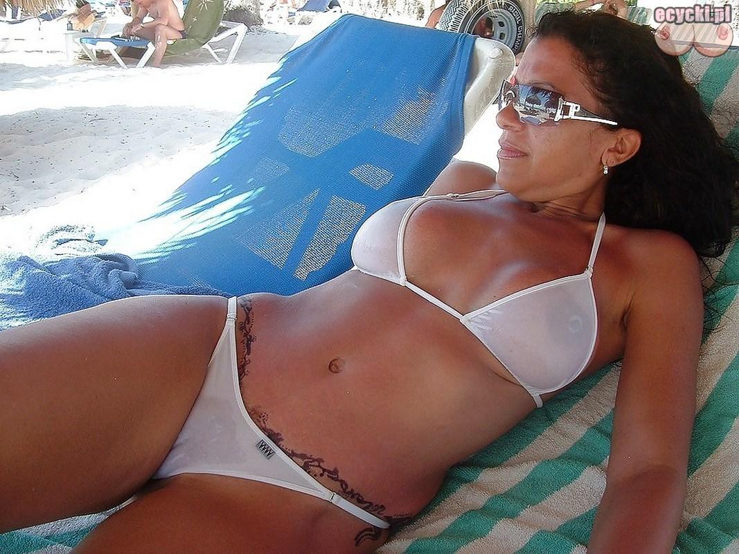 4. hot busty milf in the beach bikini